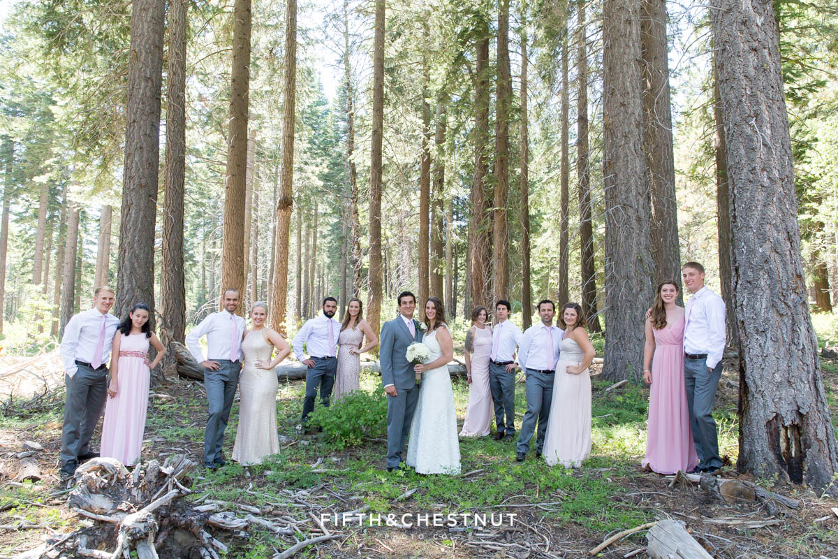 wedding party in pink and gray pose for a portrait before a North Lake Tahoe Wedding