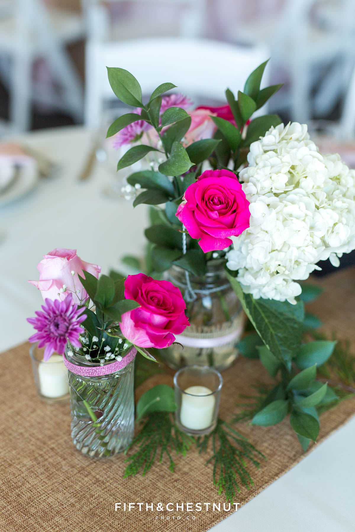 beautful roses, hydrangeas and other purple flowers set up on tables for a North Lake Tahoe Wedding