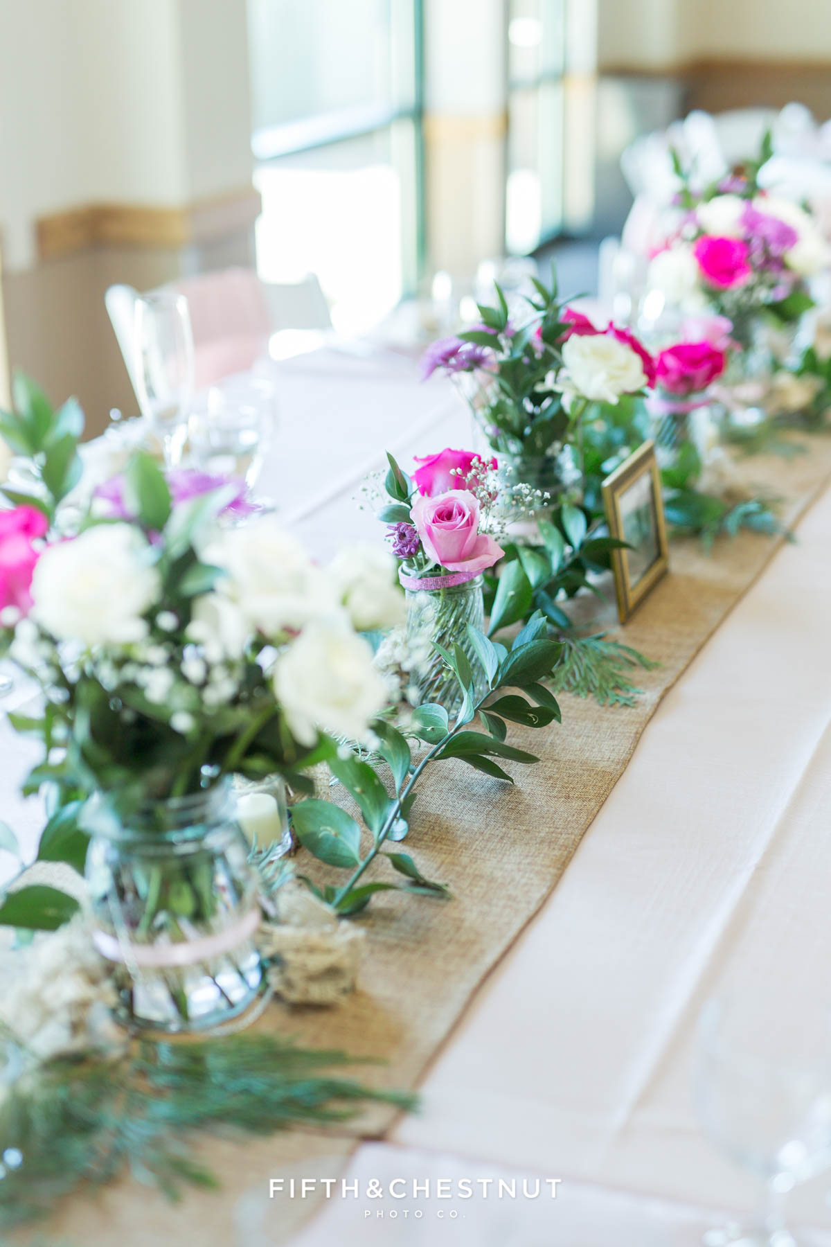 Flowers lined up on the head table for a North Lake Tahoe Wedding at North Tahoe Event Center