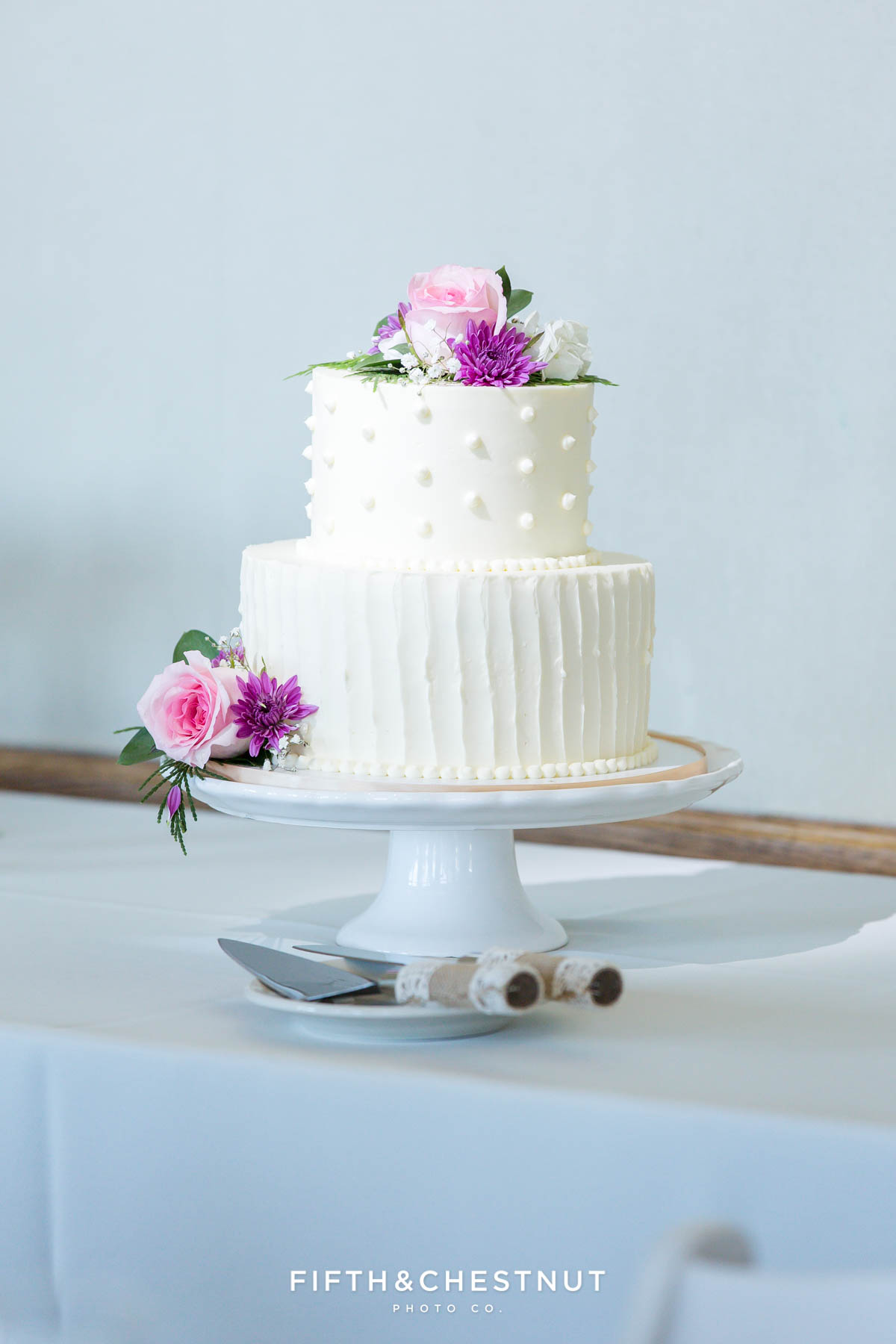 White 2-tier wedding cake with pink roses for a North Lake Tahoe Wedding by Flour Girl Wedding Cakes