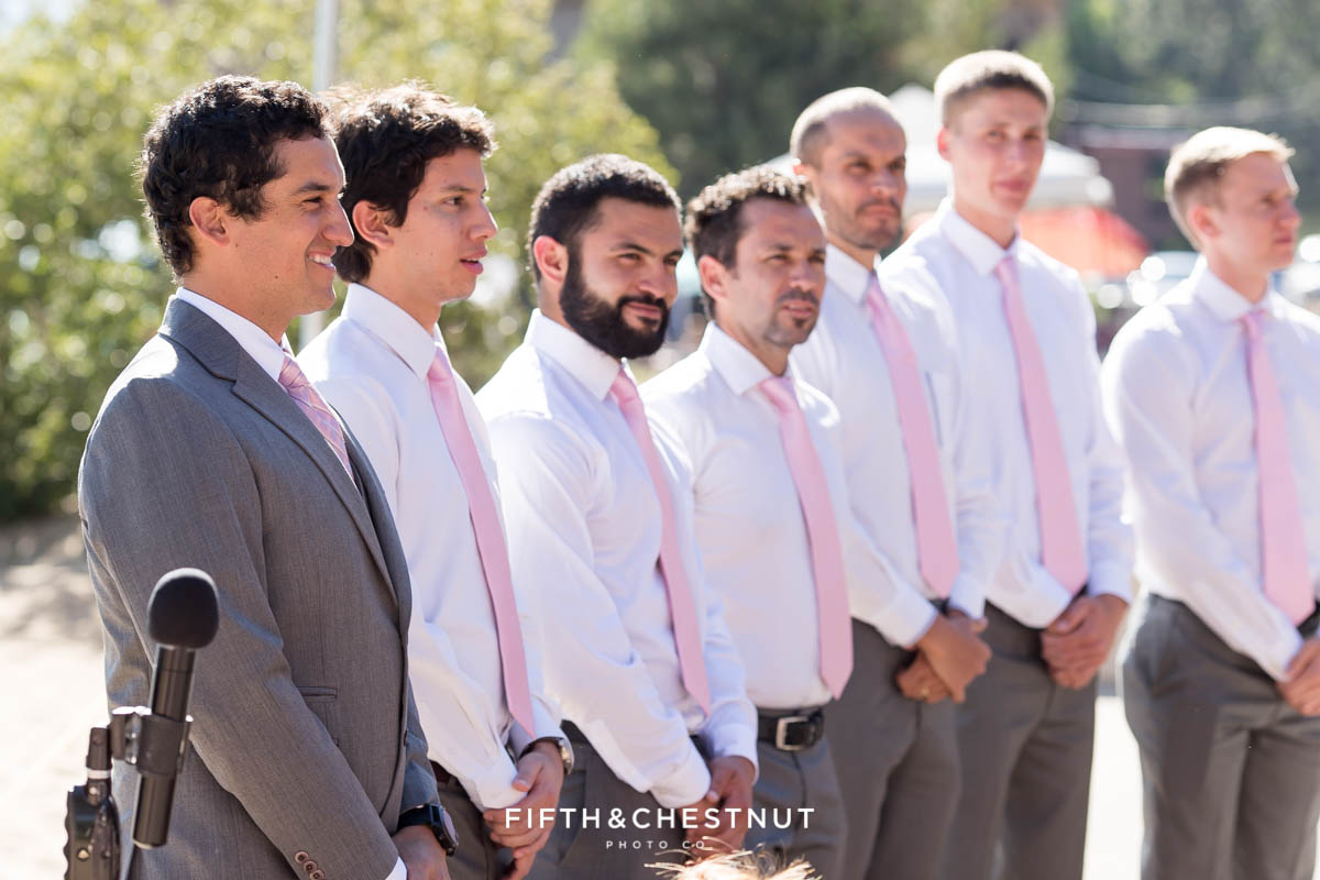 groom sees his bride walking down the aisle for their Tahoe wedding