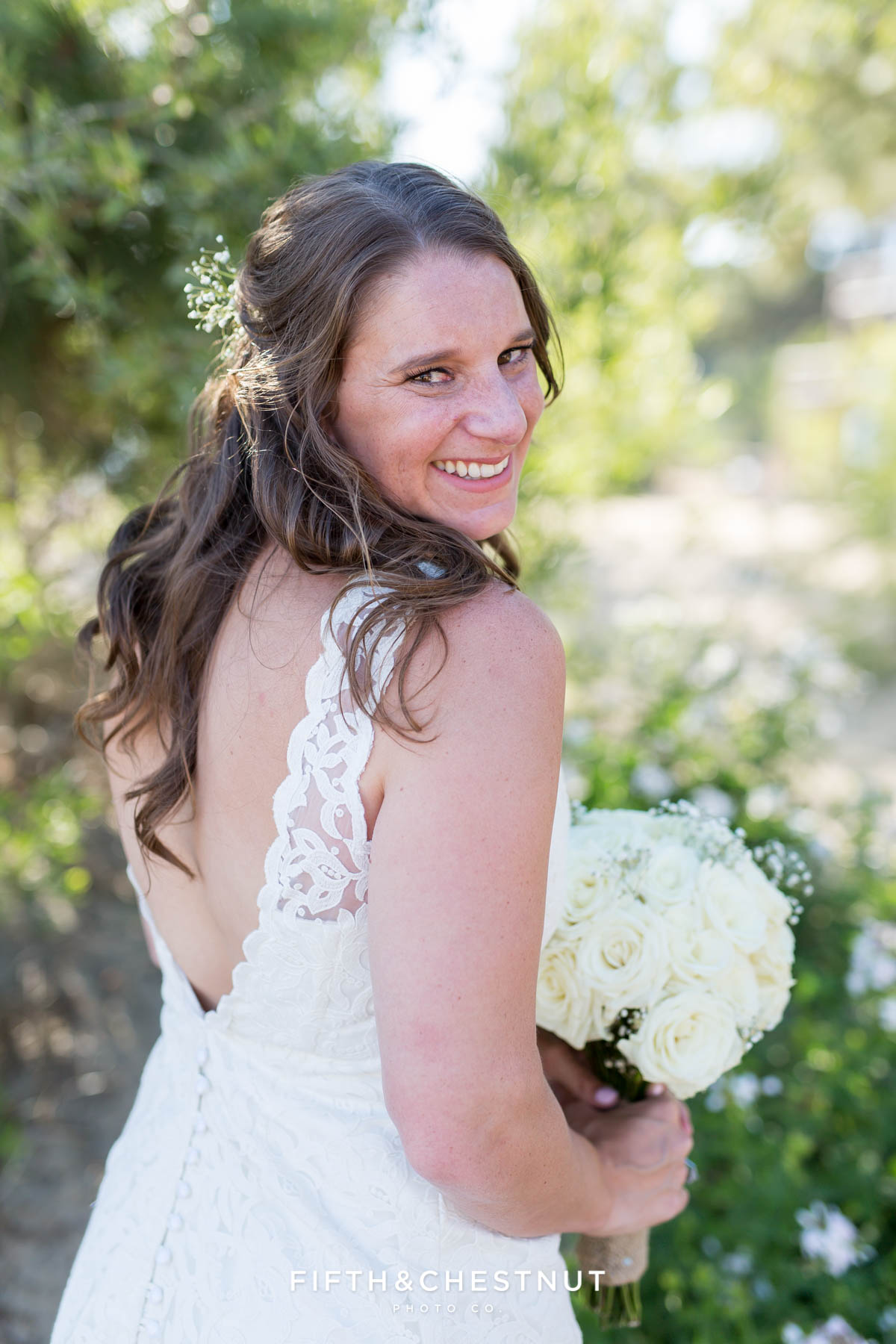 Bride shows off her lovely custom wedding gown made in Ecuador for her North Lake Tahoe Wedding by Tahoe Photographer