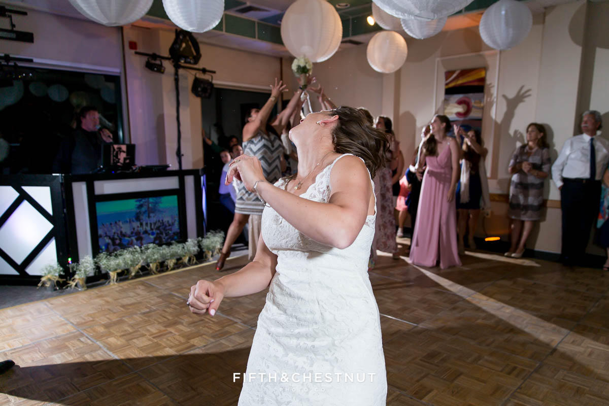 Bride throws her bouquet to the single ladies at her North Tahoe Event Center Wedding