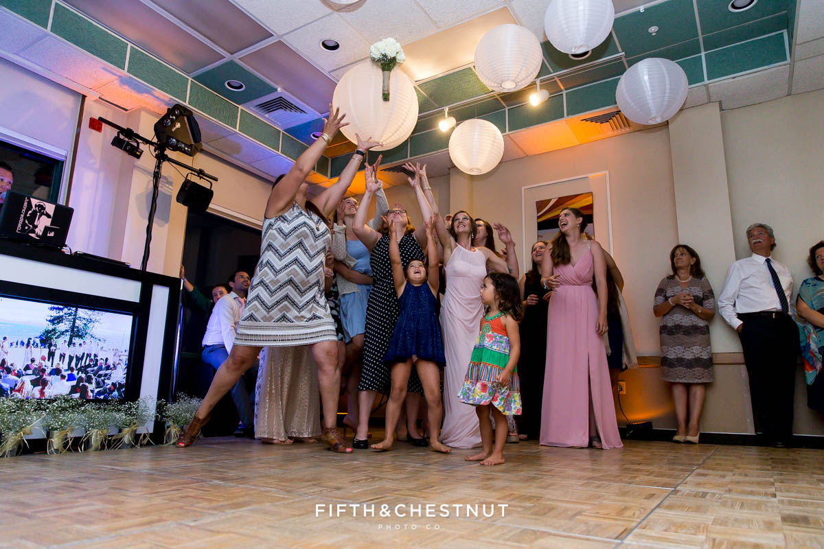 Single ladies go for the bouquet at a North Lake Tahoe Wedding by Lake Tahoe Wedding Photographer