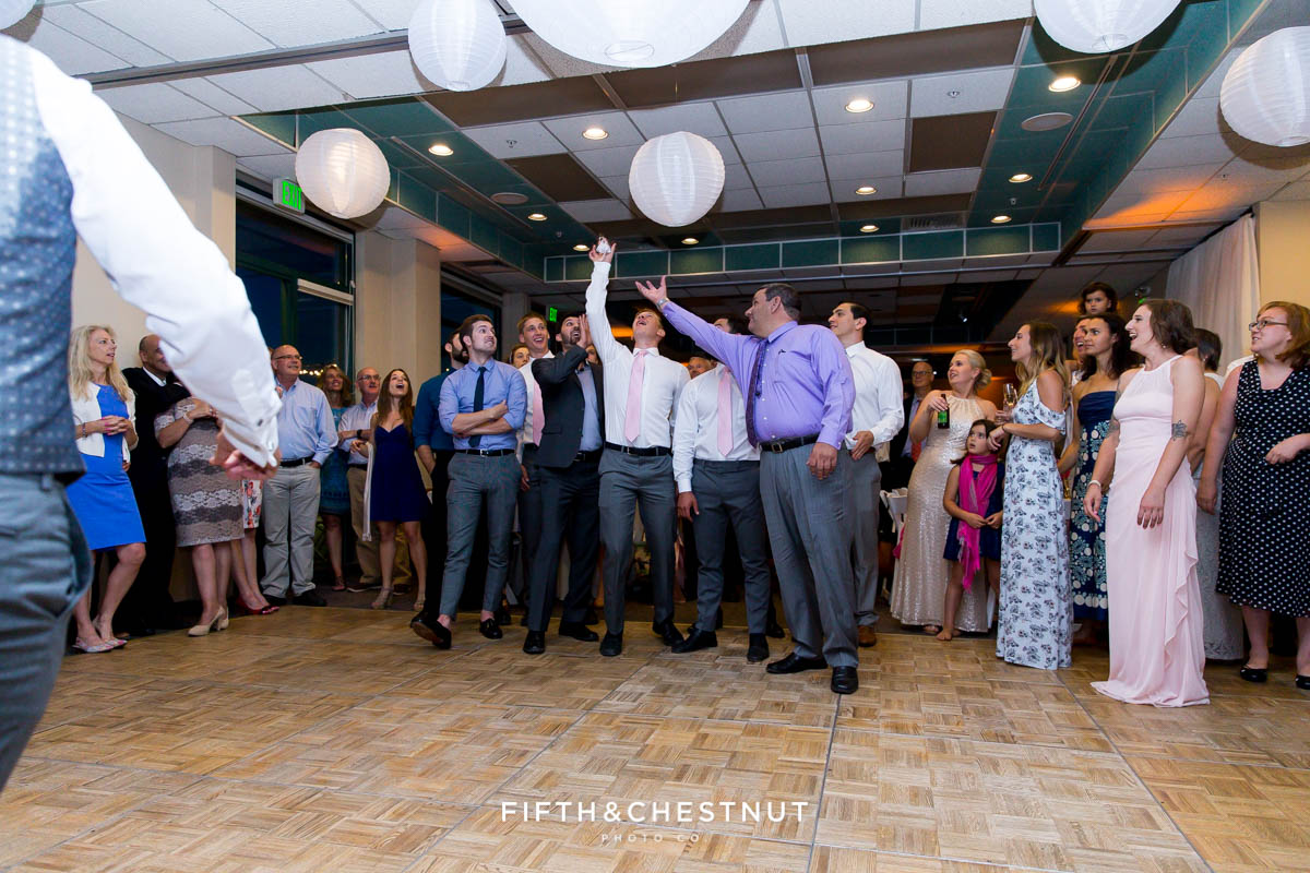 Groomsmen catching the garter at a North shore wedding