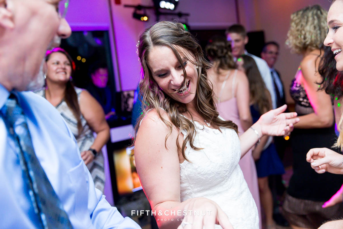 Bride dancing during her North Tahoe Event Center Wedding