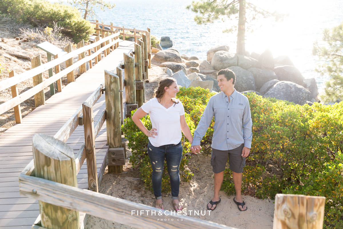 Couple standing side by side holding hands for their summer Tahoe engagement
