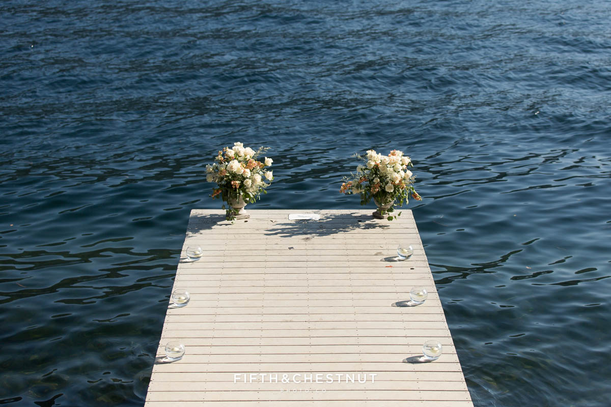 A private dock on Donner Lake decorated with floating candles and floral arrangements for a Donner Lake Proposal