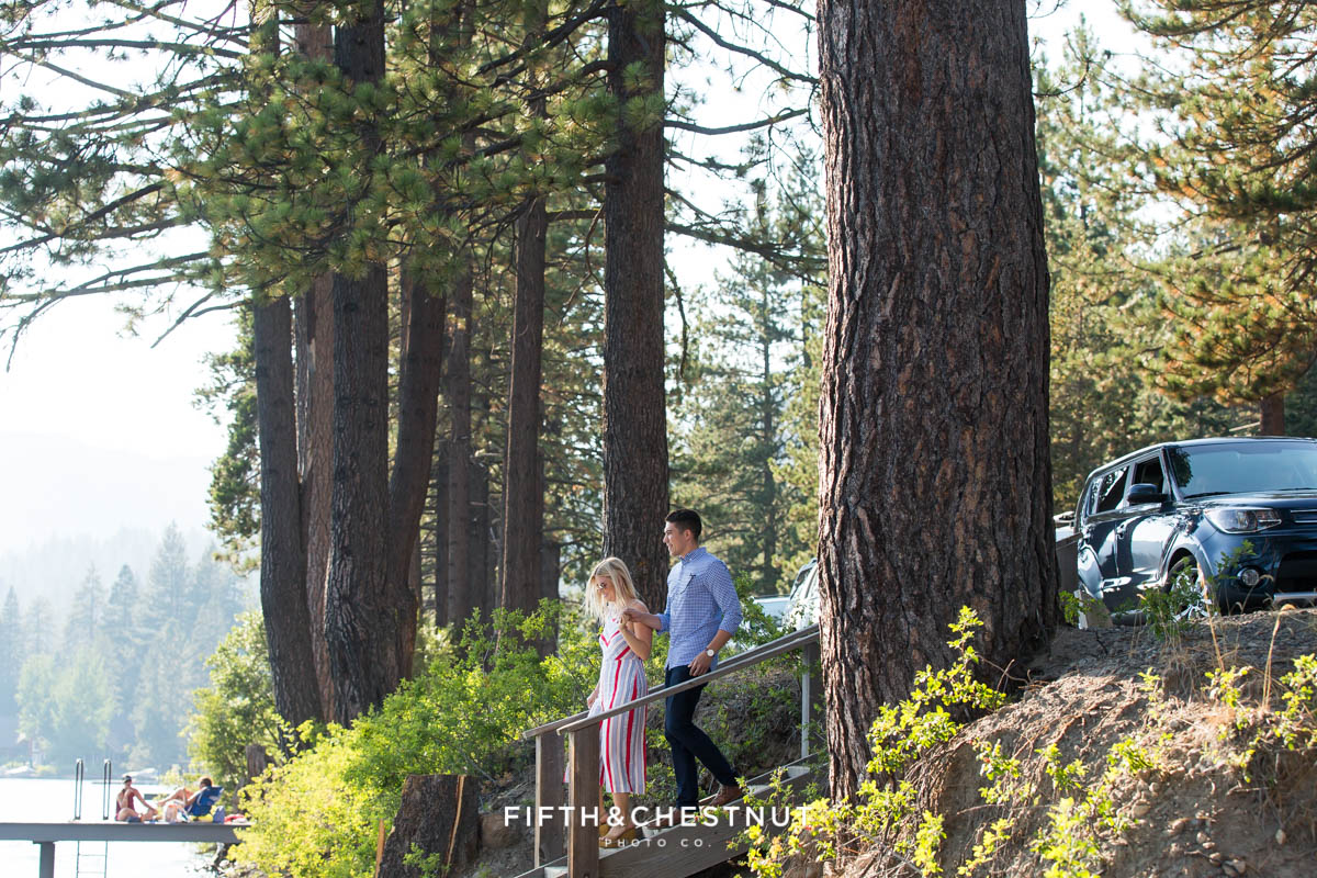 couple walks down steps towards private dock for a Donner Lake Proposal