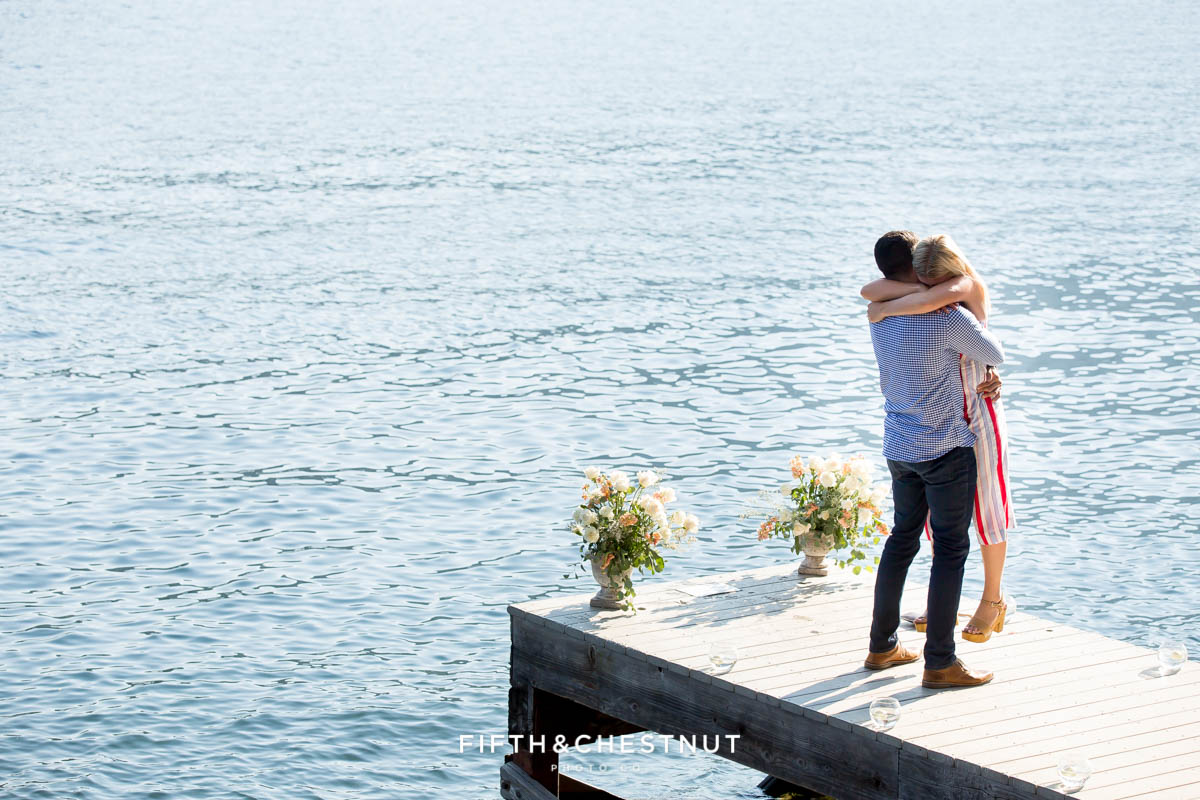 Newly engaged couple embraces on a dock after thier Donner Lake Proposal