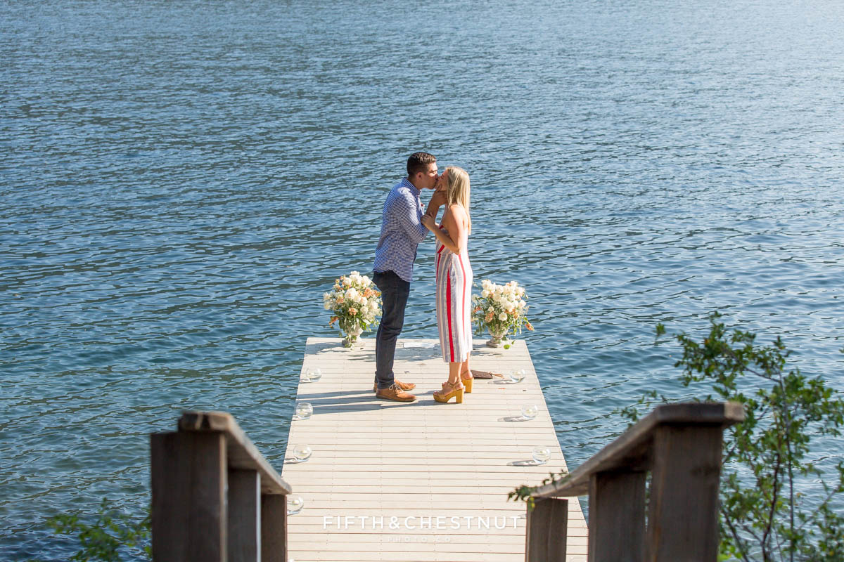 Newly engaged couple kiss on dock after their Donner Lake Proposal