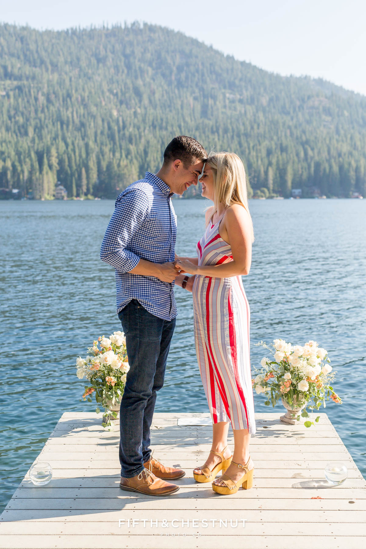 Bride and groom to be rest foreheads together after a Donner Lake Proposal
