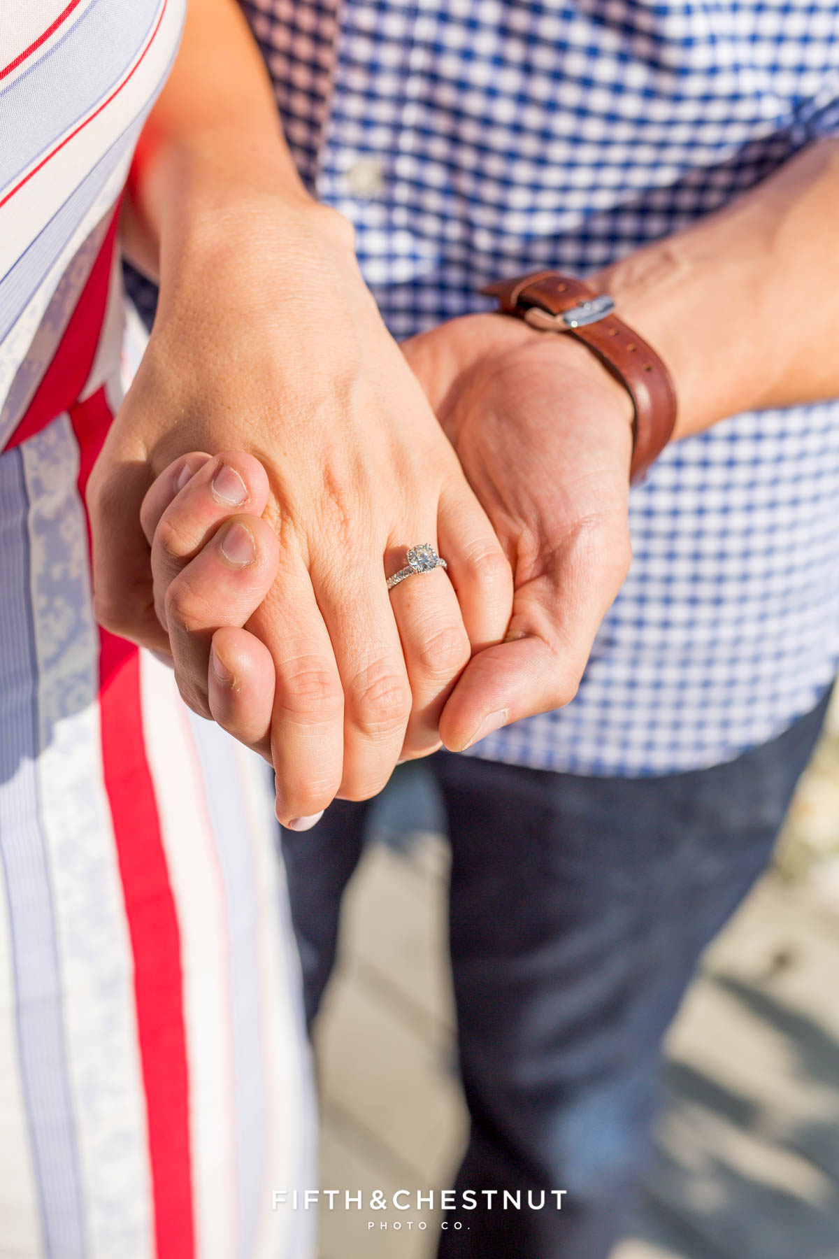 Closeup of new engagement ring while couple holds hands in Truckee after their proposal