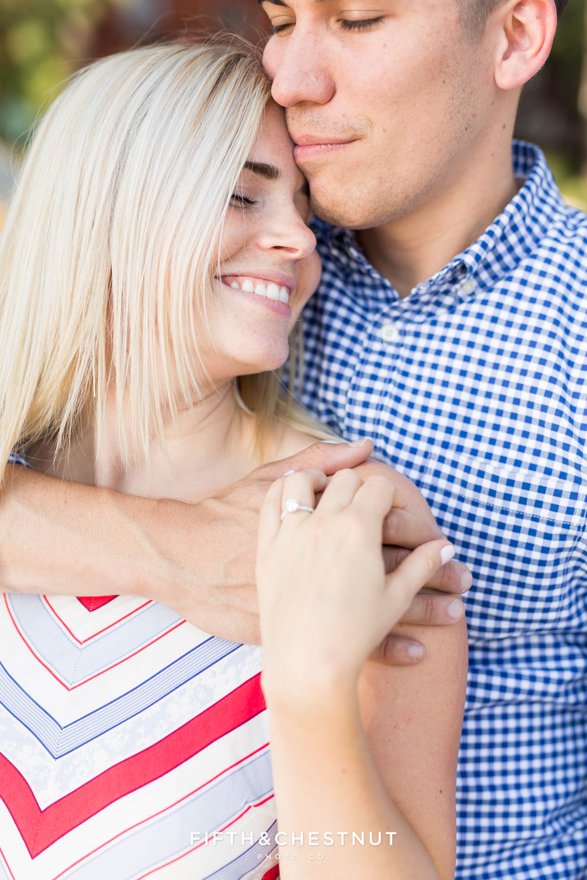 couple celebrates and embraces after their Donner Lake Proposal