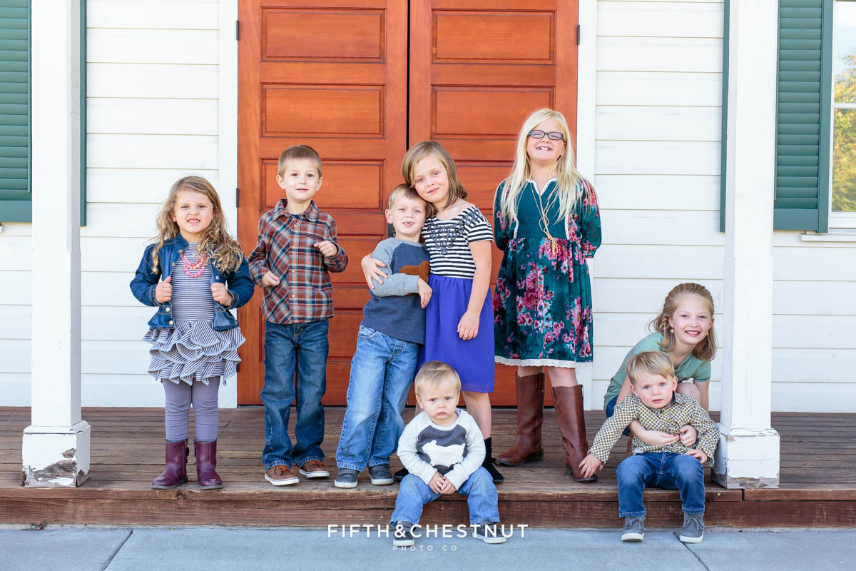seven grandchildren pose for Bartley Ranch Portraits by Reno family photographer
