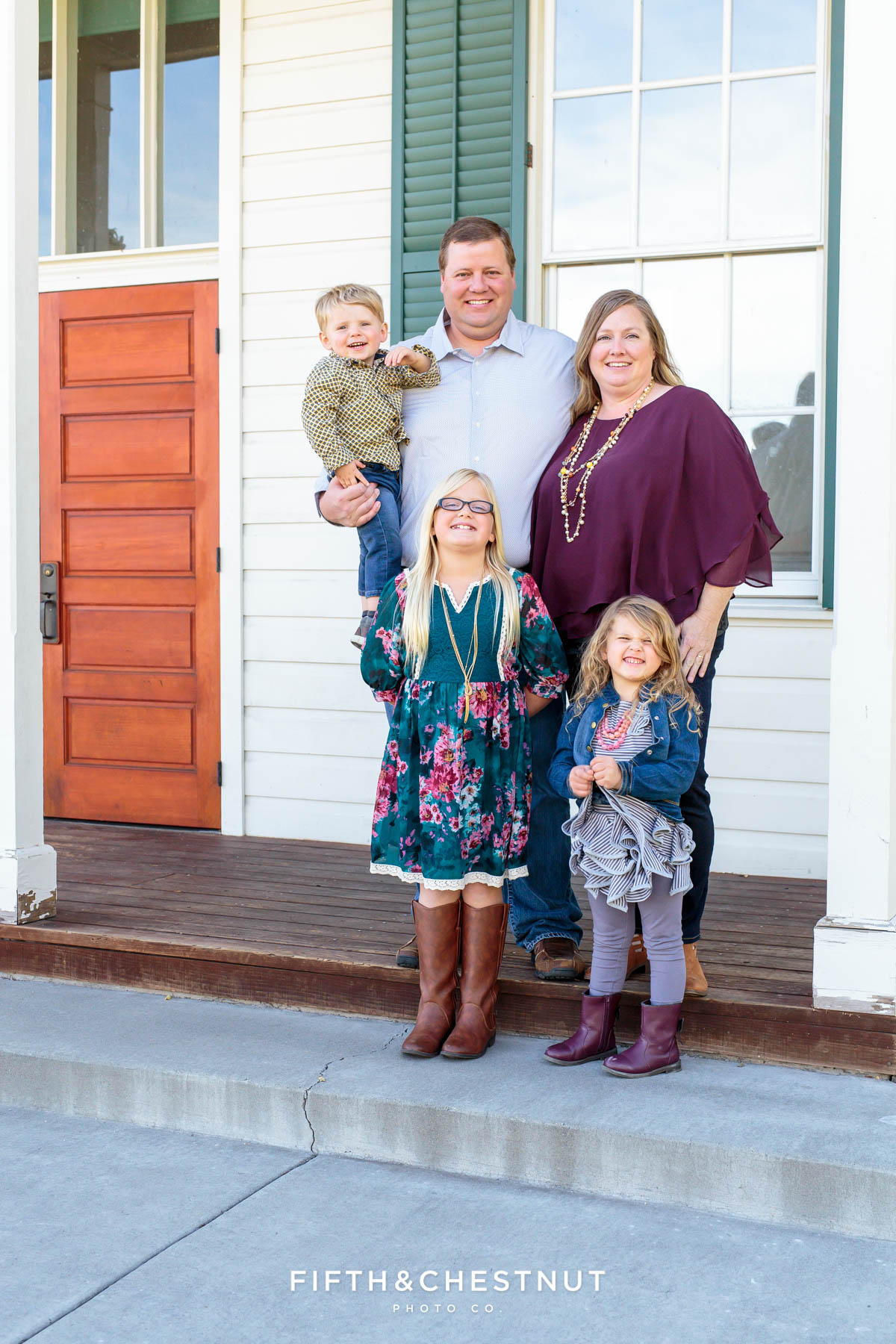 family of five wearing teal and purple poses for Bartley Ranch Portraits by Reno Family Photographer