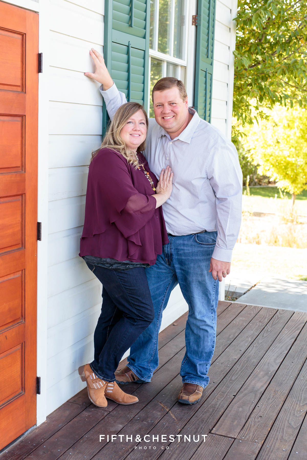husband and wife snuggle for fall Bartley Ranch Portraits by Reno Family Photographer