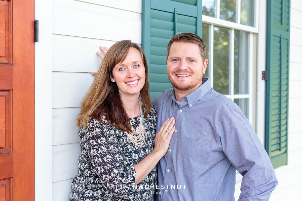 husband and wife smile and snuggle for Bartley Ranch Portraits by Reno Family Photographer