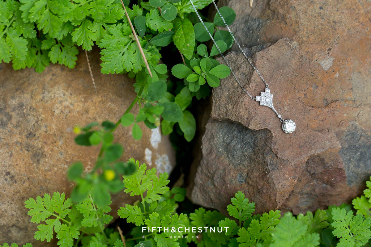 sparkly necklace on a rock for a Greenhorn Creek Guest Ranch Wedding