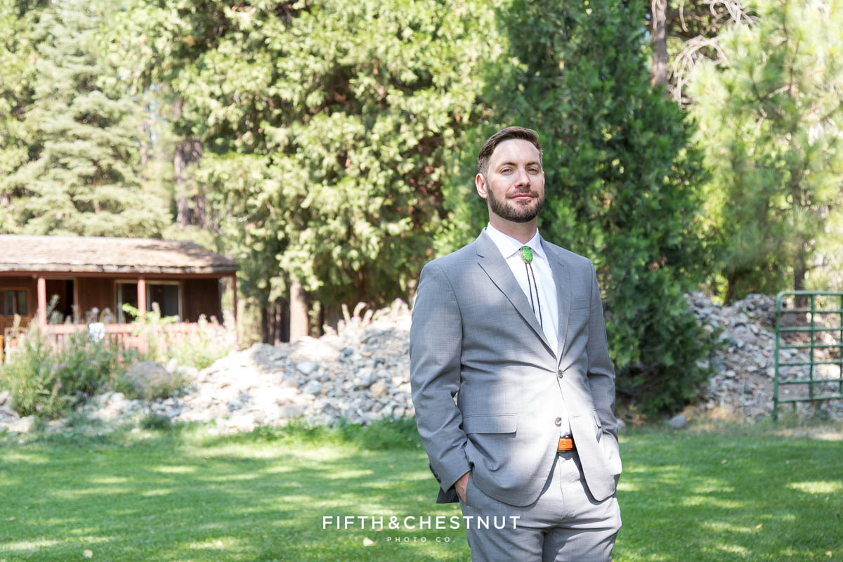 groom awaits his bride for their first look before their summer Greenhorn Creek Guest Ranch Wedding