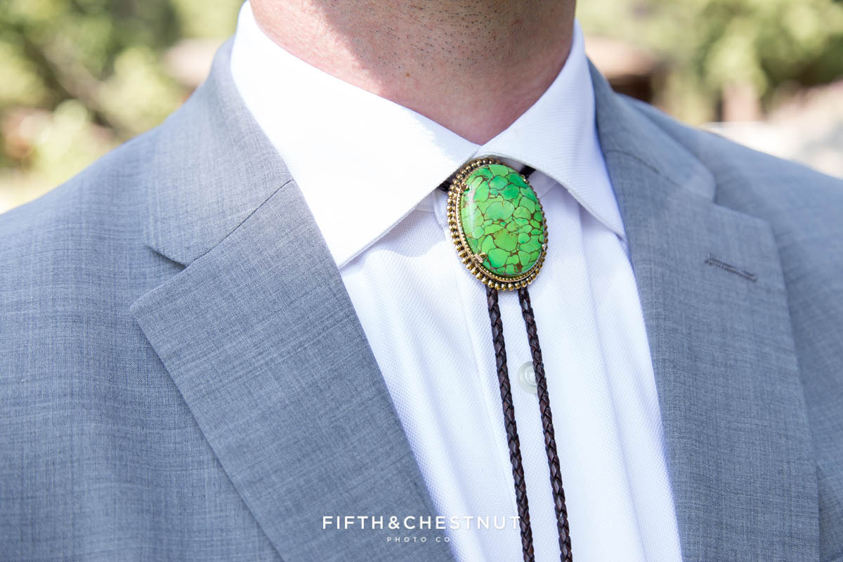 detail shot of groom's bolo tie for his Greenhorn Creek Guest Ranch Wedding