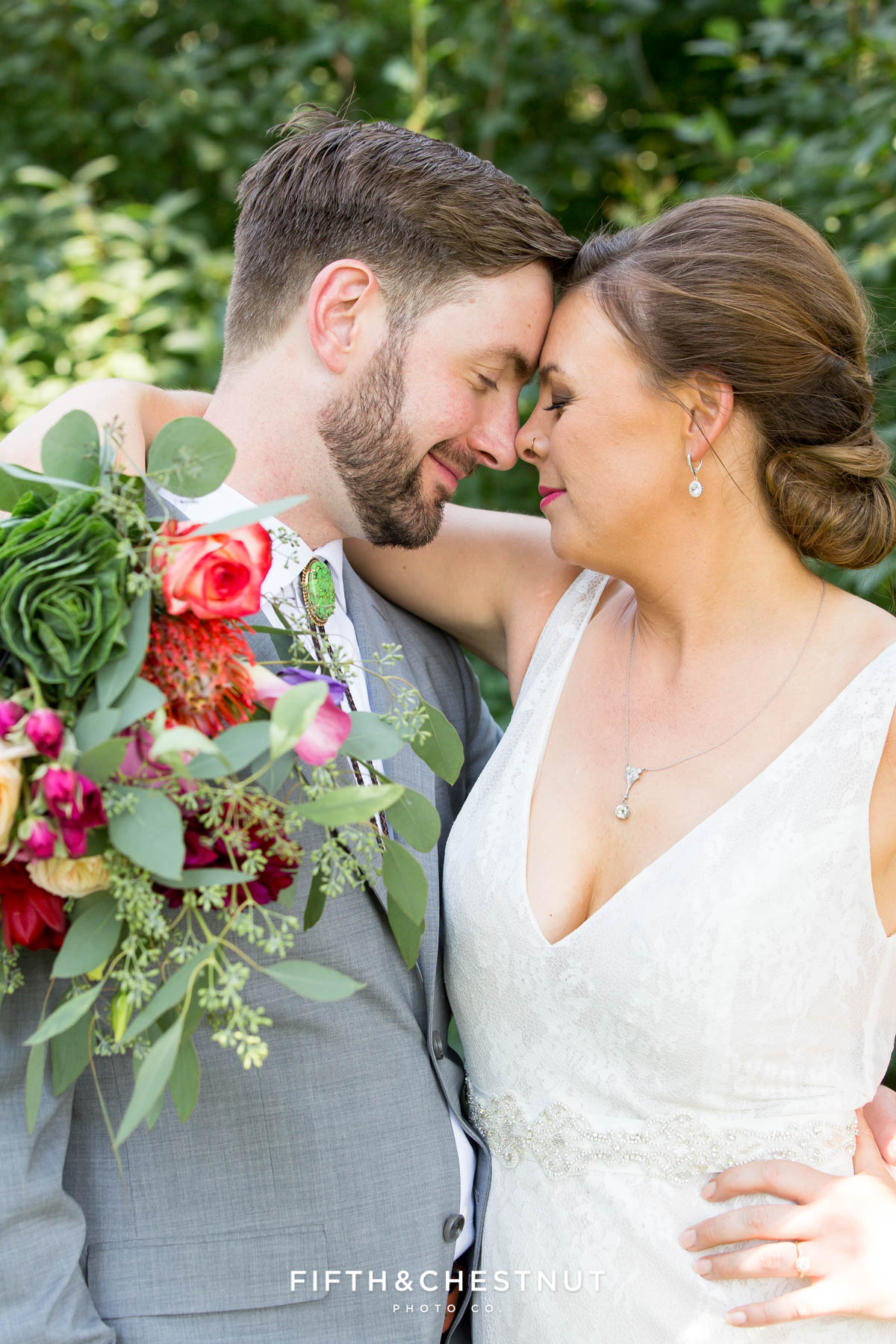 romantic bride and groom portrait with their heads together showing the bride's beautiful bouquet at their Greenhorn Creek Guest Ranch Wedding