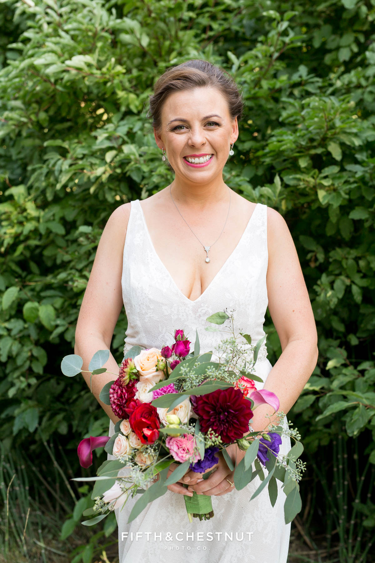 bride holds her beautiful bright summer wedding bouquet for her Greenhorn Creek Guest Ranch Wedding