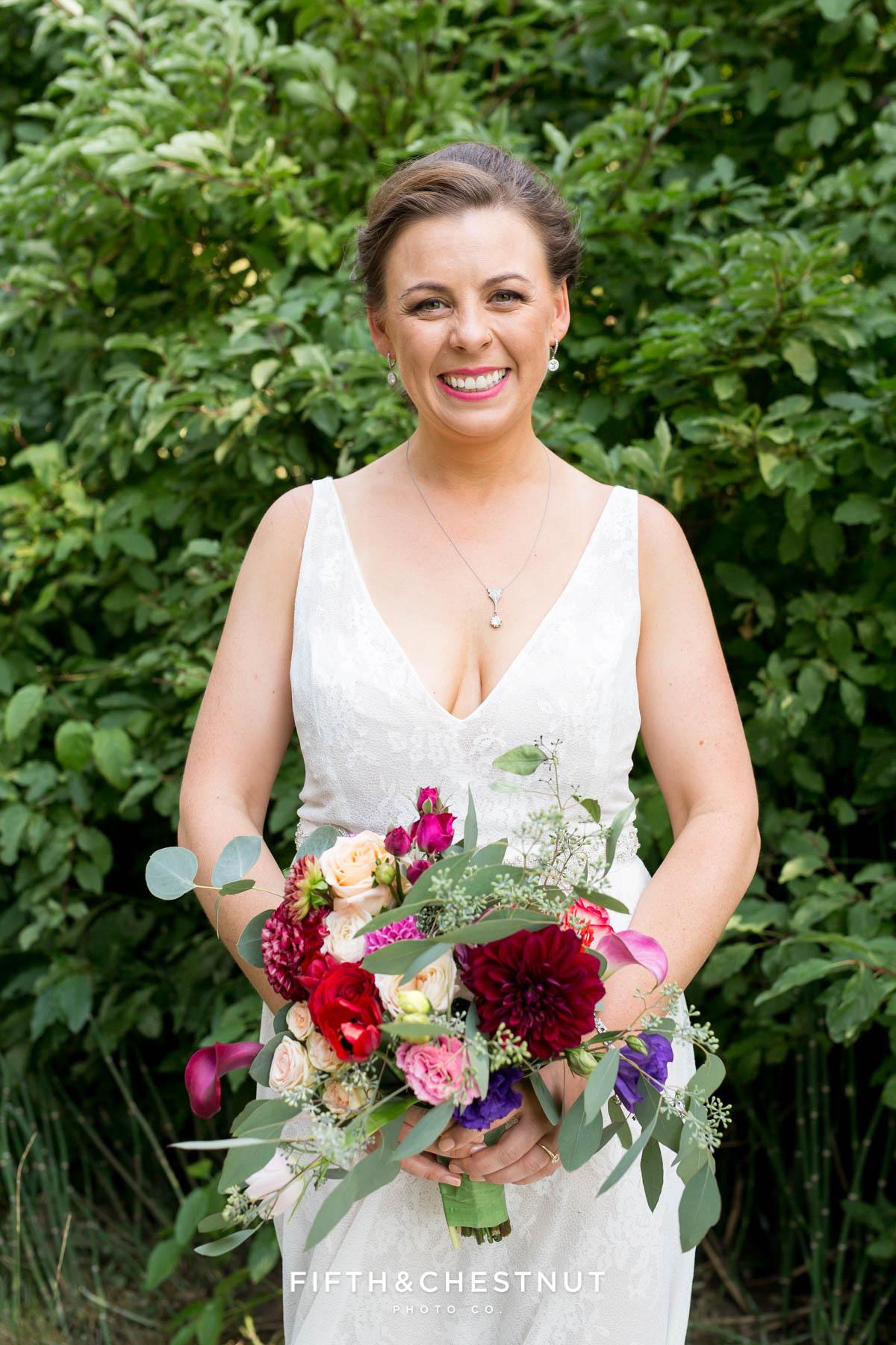 bride holds her beautiful bright summer wedding bouquet for her Greenhorn Creek Guest Ranch Wedding