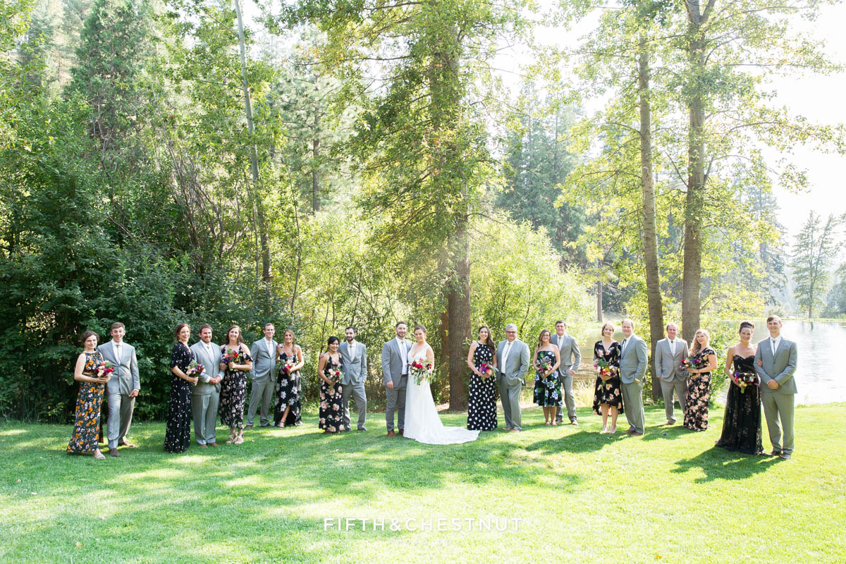 wedding party in gray suits and floral dresses for a bright and summery wedding bouquet for a Greenhorn Creek Guest Ranch Wedding