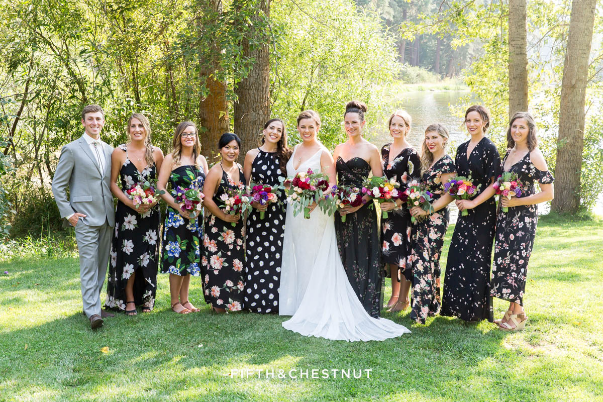 bride party wearing floral dresses for a wedding party in gray suits and floral dresses for a bright and summery wedding bouquet for a Greenhorn Creek Guest Ranch Wedding