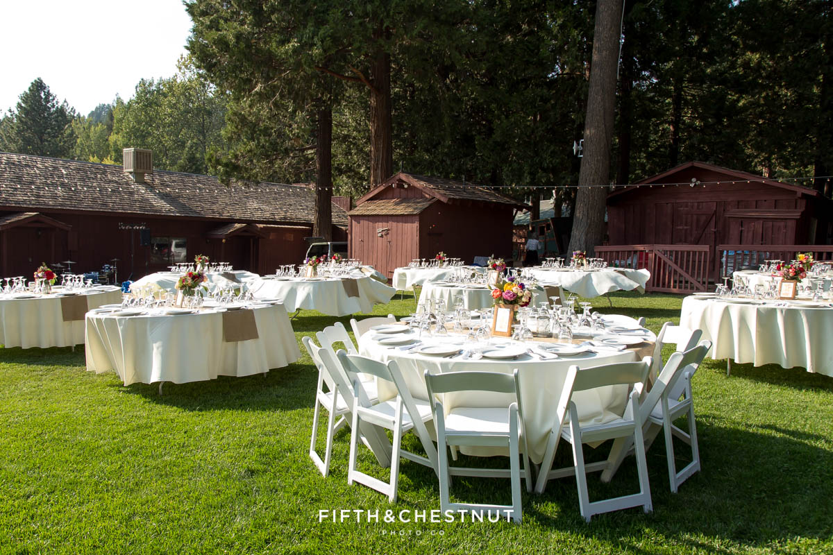 Wedding reception details for a wedding party in gray suits and floral dresses for a bright and summery wedding bouquet for a Greenhorn Creek Guest Ranch Wedding