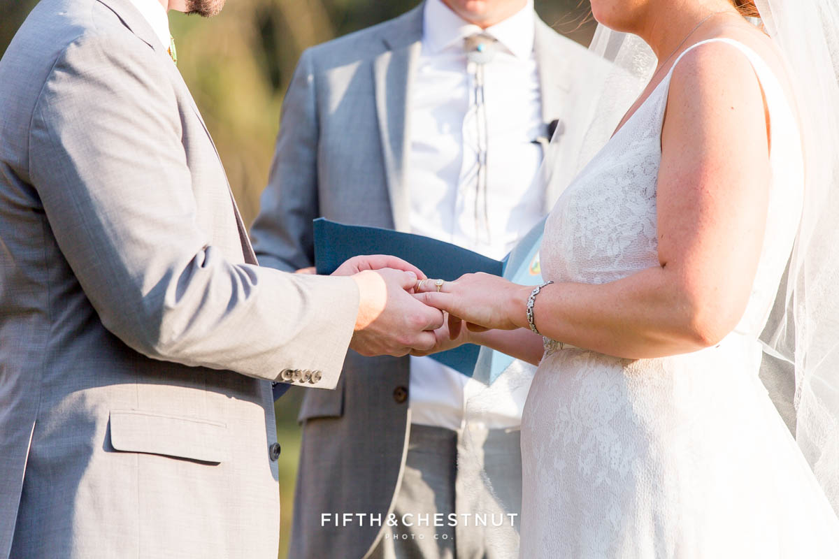 exchange of rings at a Greenhorn Creek Guest Ranch Wedding