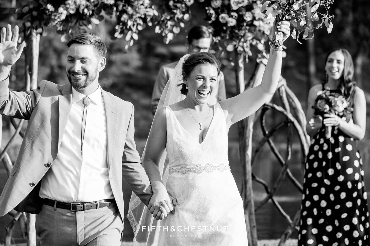 bride and groom walk back down the aisle as husband and wife