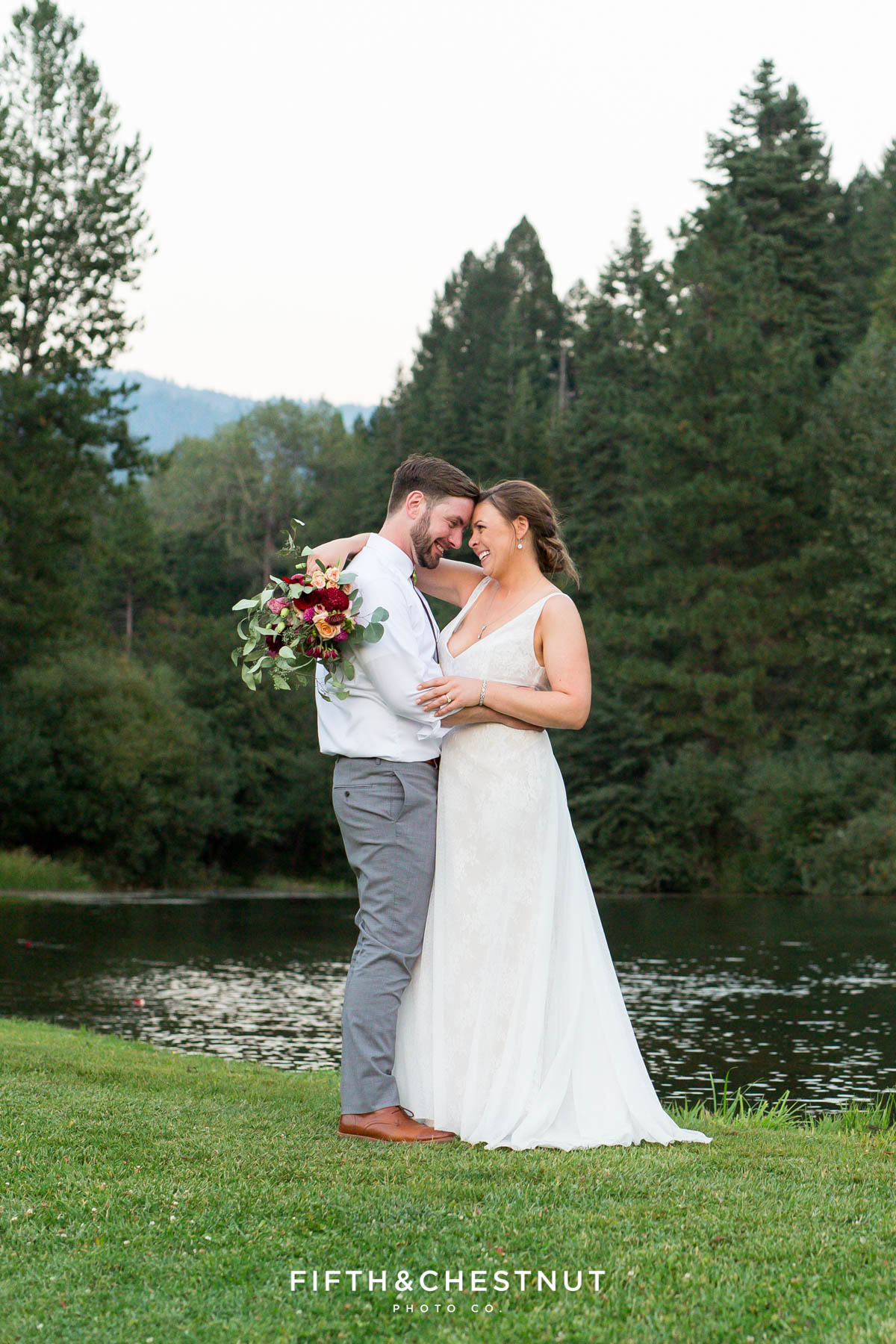 romantic portrait of bride and groom in front of a pond in Quincy, CA