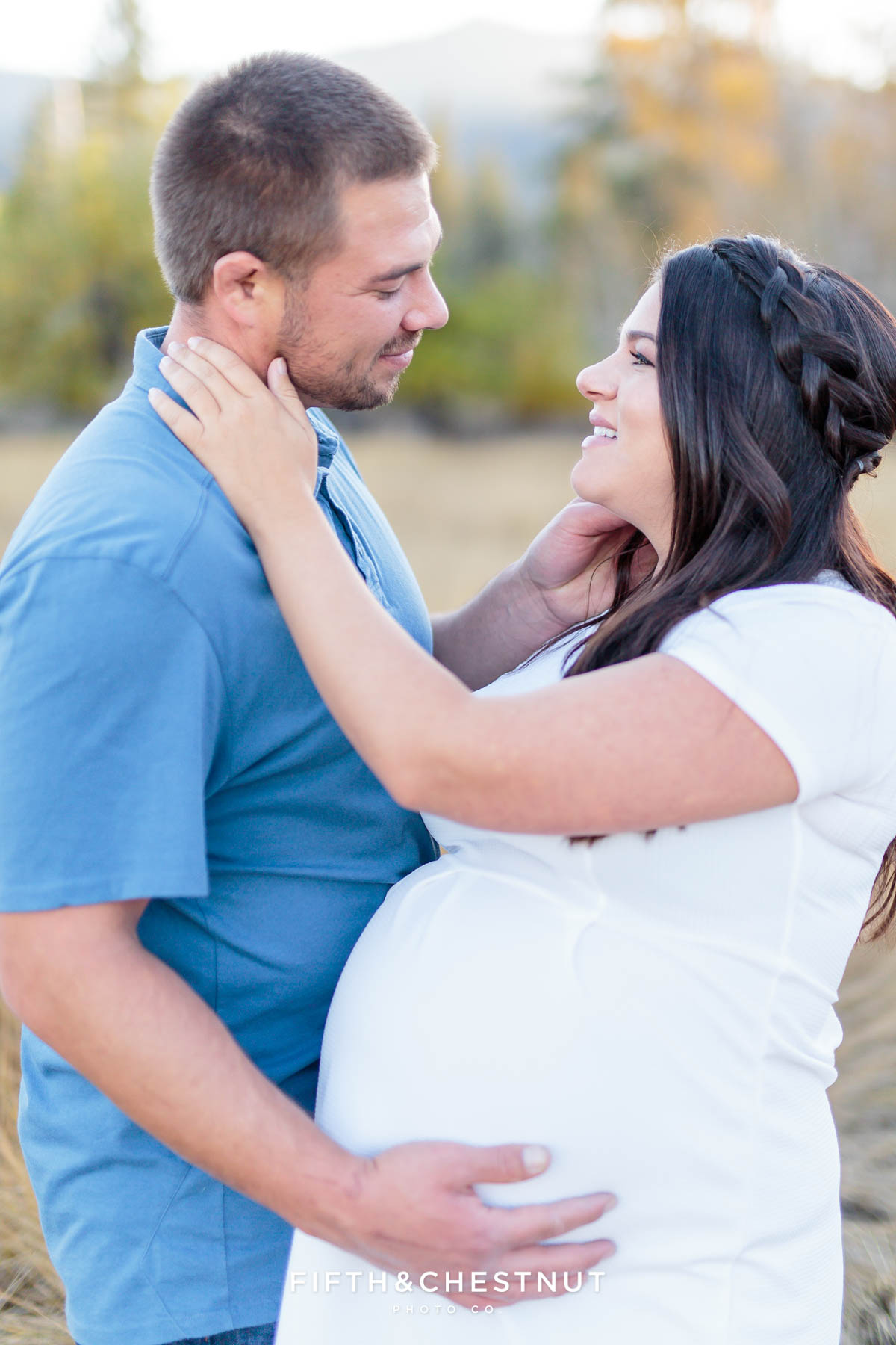 Husband caresses his pregnant wife's cheek for fall maternity portraits by Reno Maternity Photographer