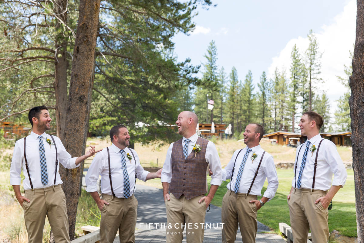 Groom laughs with his groomsmen before a PJ's at Gray's Crossing wedding in the forest