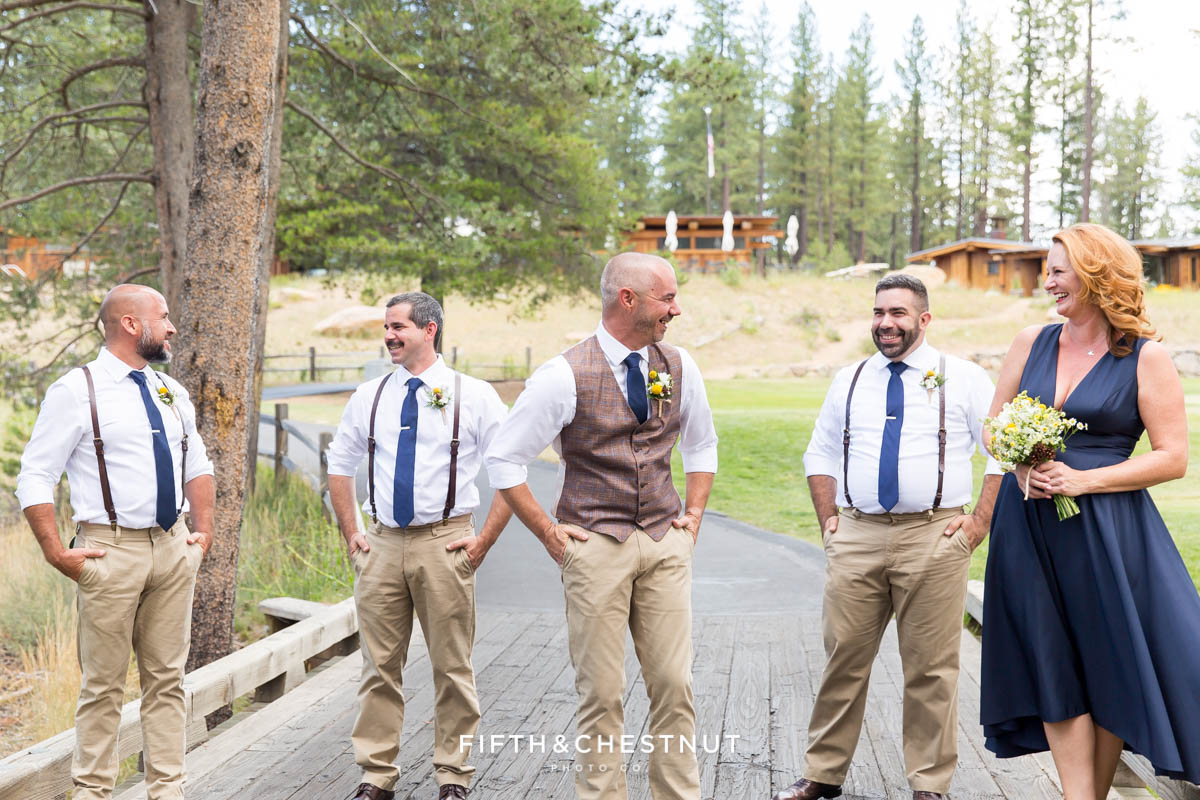 Groom laughs with his wedding party before his same-sex wedding at PJ's at Gray's Crossing in Truckee