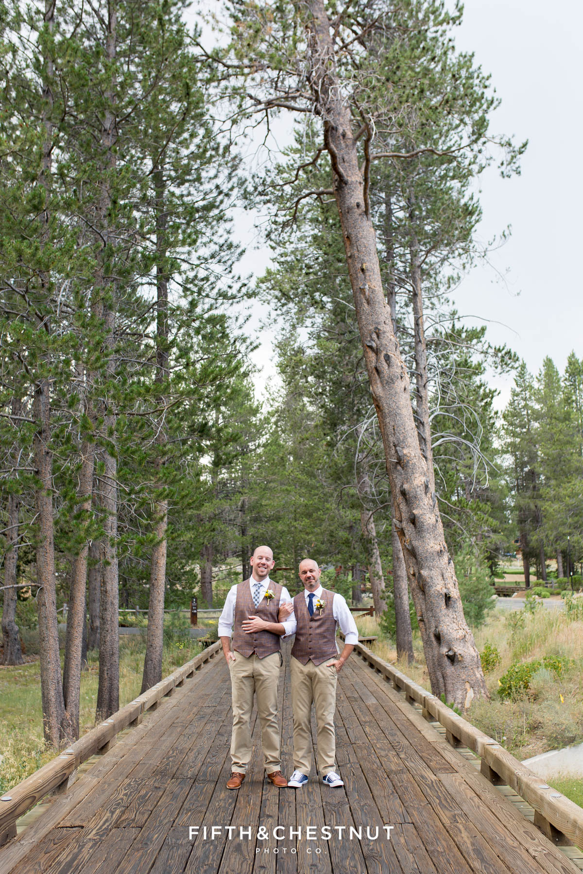 Grooms embrace on wooden path together before their PJ's at Gray's Crossing wedding