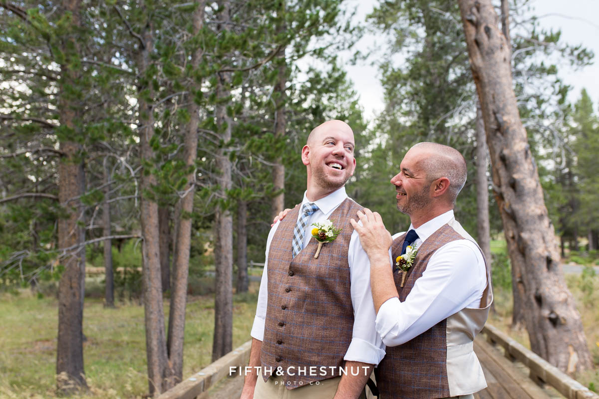 Grooms smile at one another before their beautiful PJ's at Gray's Crossing wedding