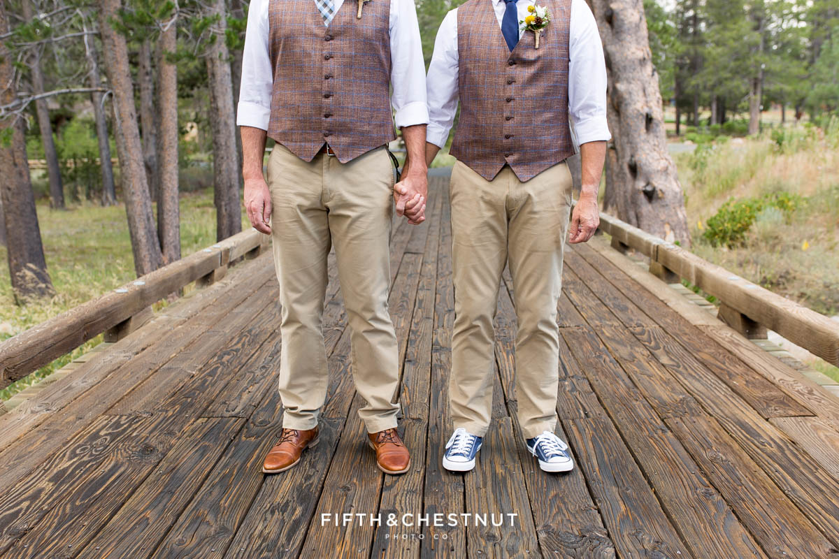 Portrait of grooms' shoes at they stand together on wooden bridge for their same-sex wedding in Truckee