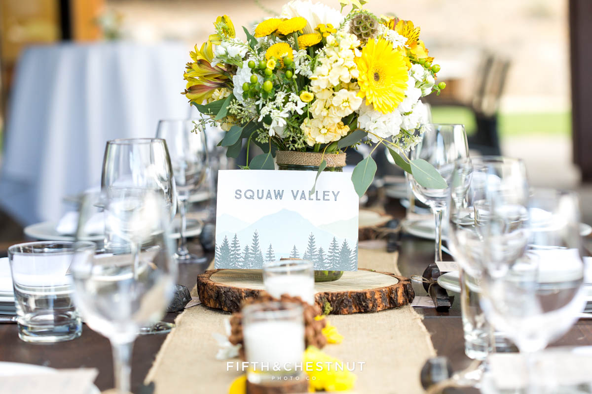 Table setting and yellow flowers by Suzu's Petals for a Truckee Wedding at PJ's at Gray's Crossing
