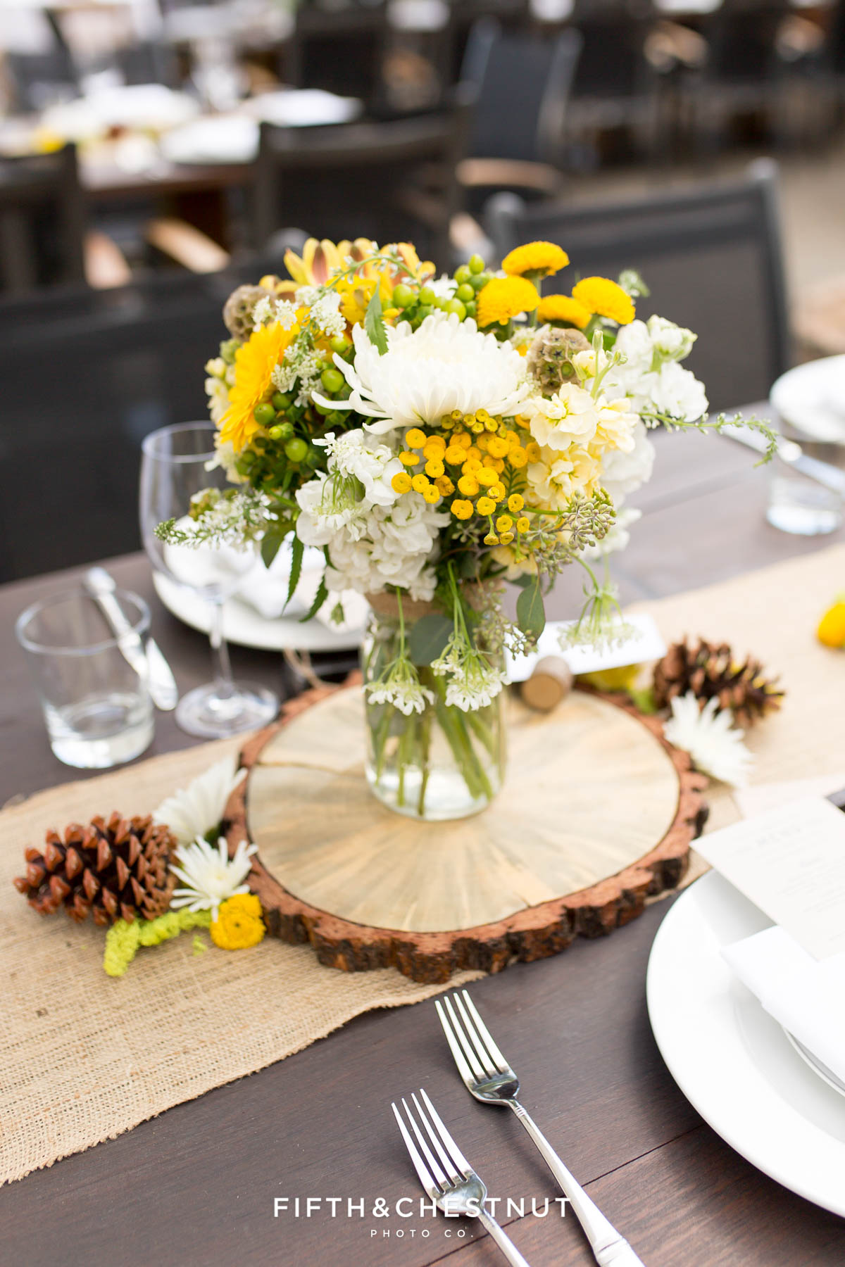 Vase full of white and yellow summer flowers for a PJ's at Gray's Crossing wedding