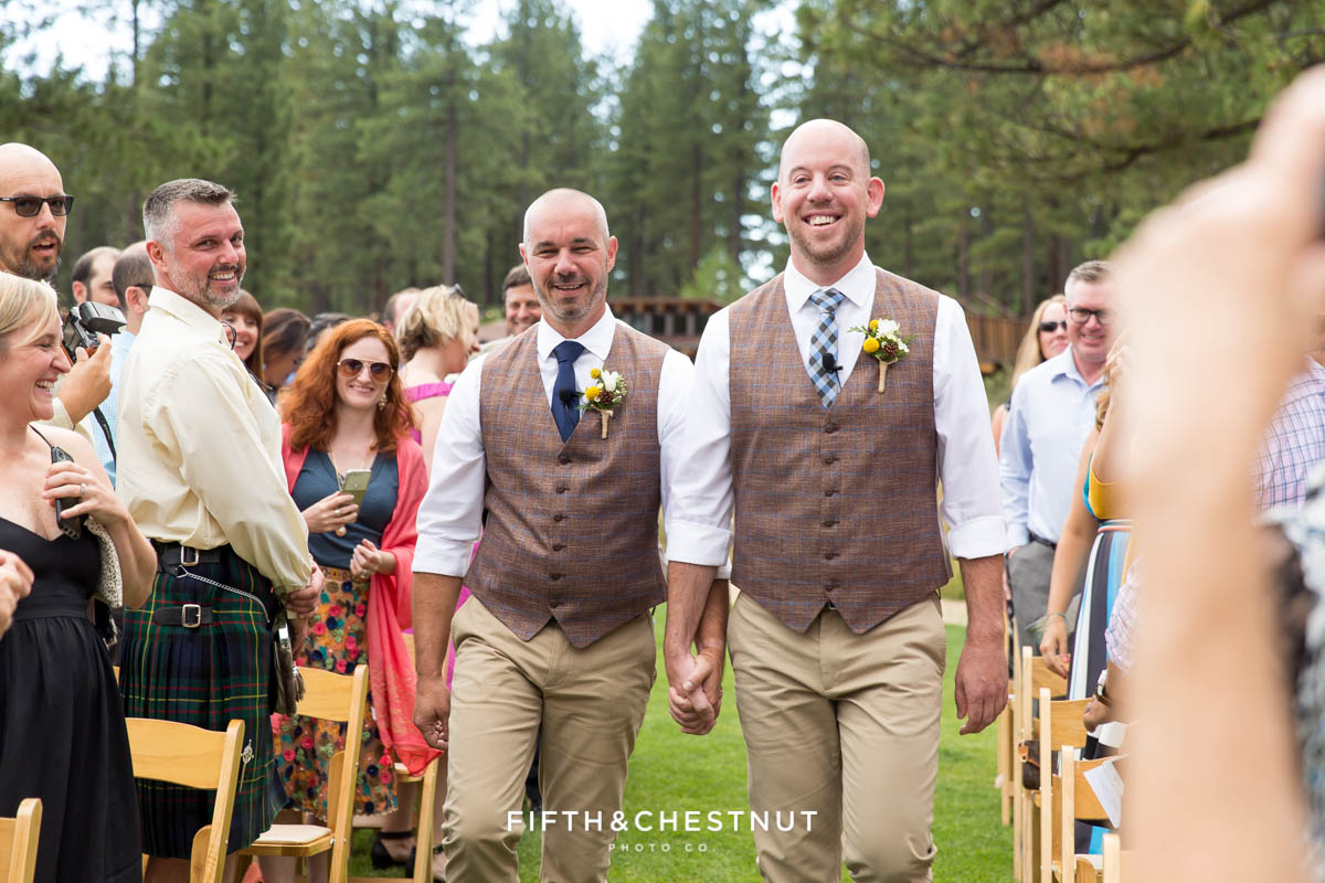 Grooms smile as they head down the aisle hand-in-hand for their PJ's at Gray's Crossing wedding