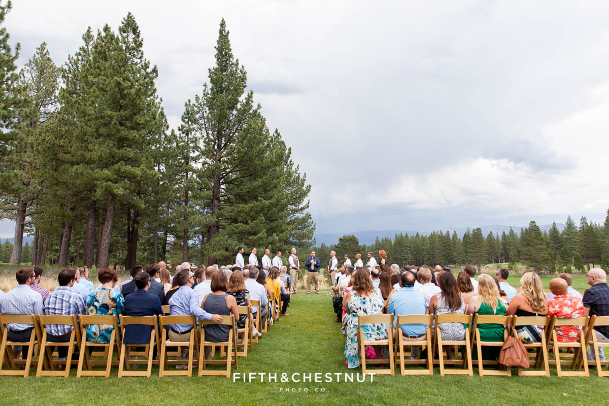 Wedding ceremony takes place under moody and cloudy skies in Truckee for a PJ's at Gray's Crossing wedding