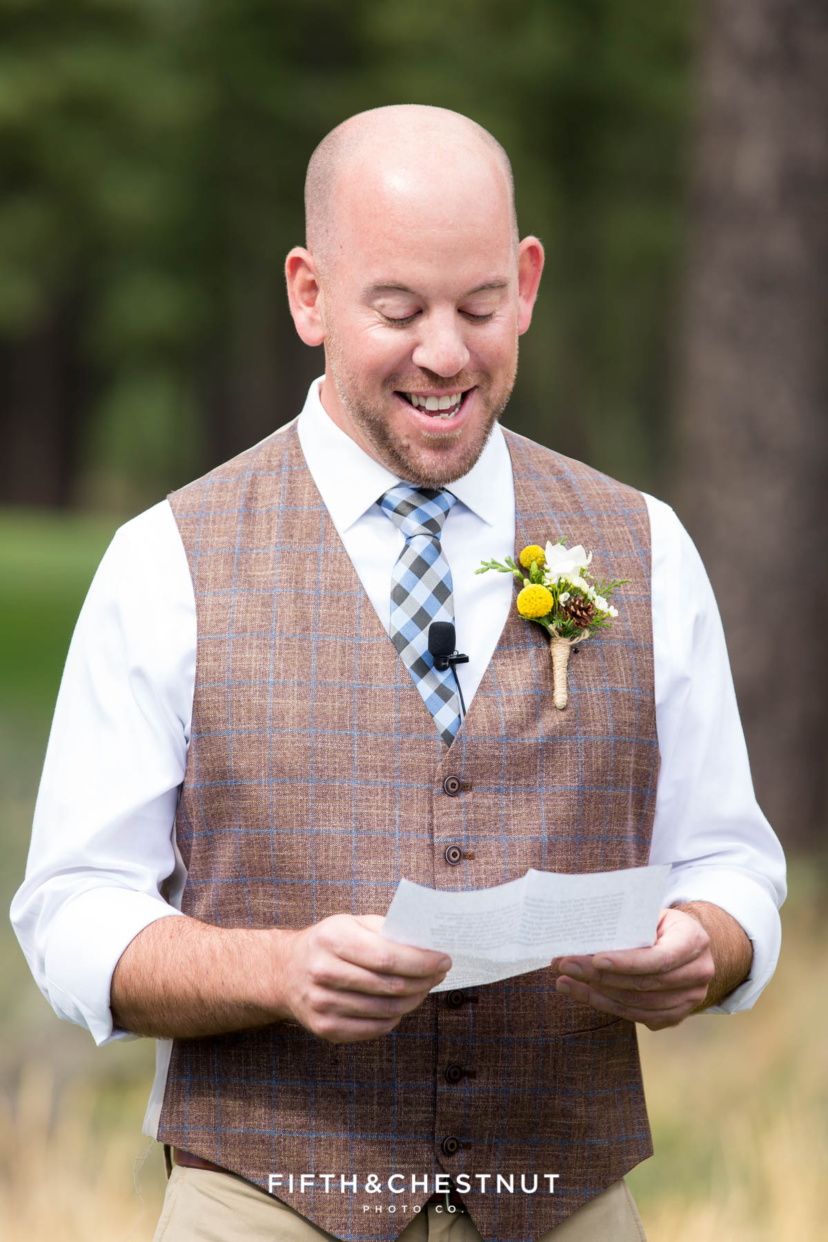 Groom reads his vows to his groom at their same-sex wedding in Truckee