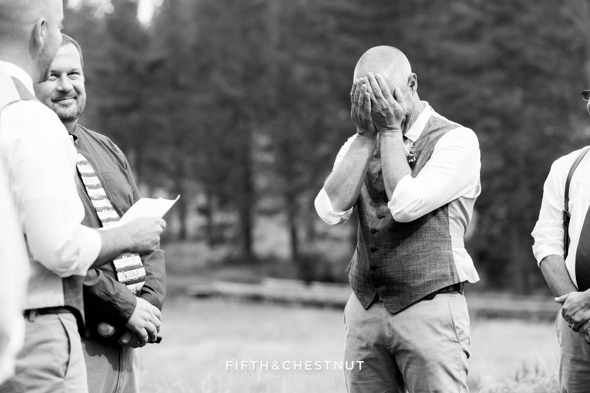 Groom hides his tears during wedding ceremony at a Truckee Wedding at PJ's at Gray's Crossing