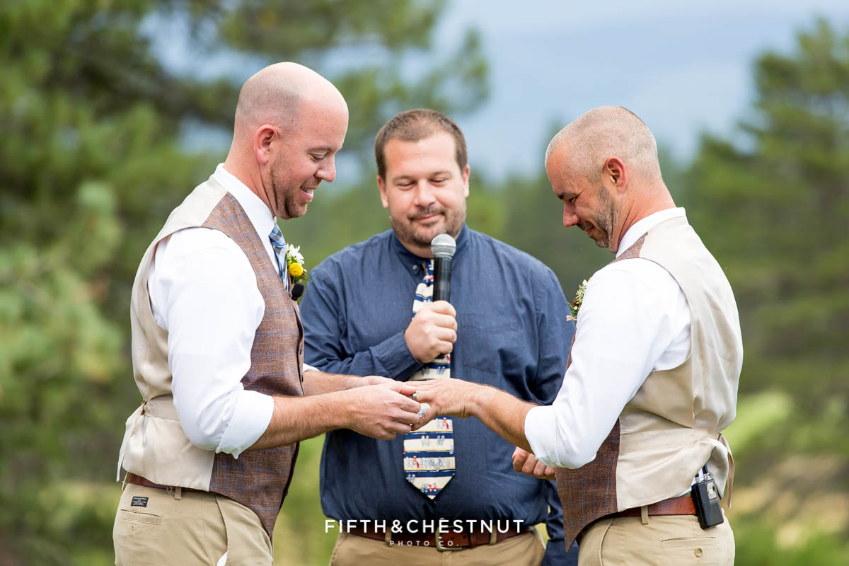 Grooms exchange rings at a same-sex wedding in Truckee