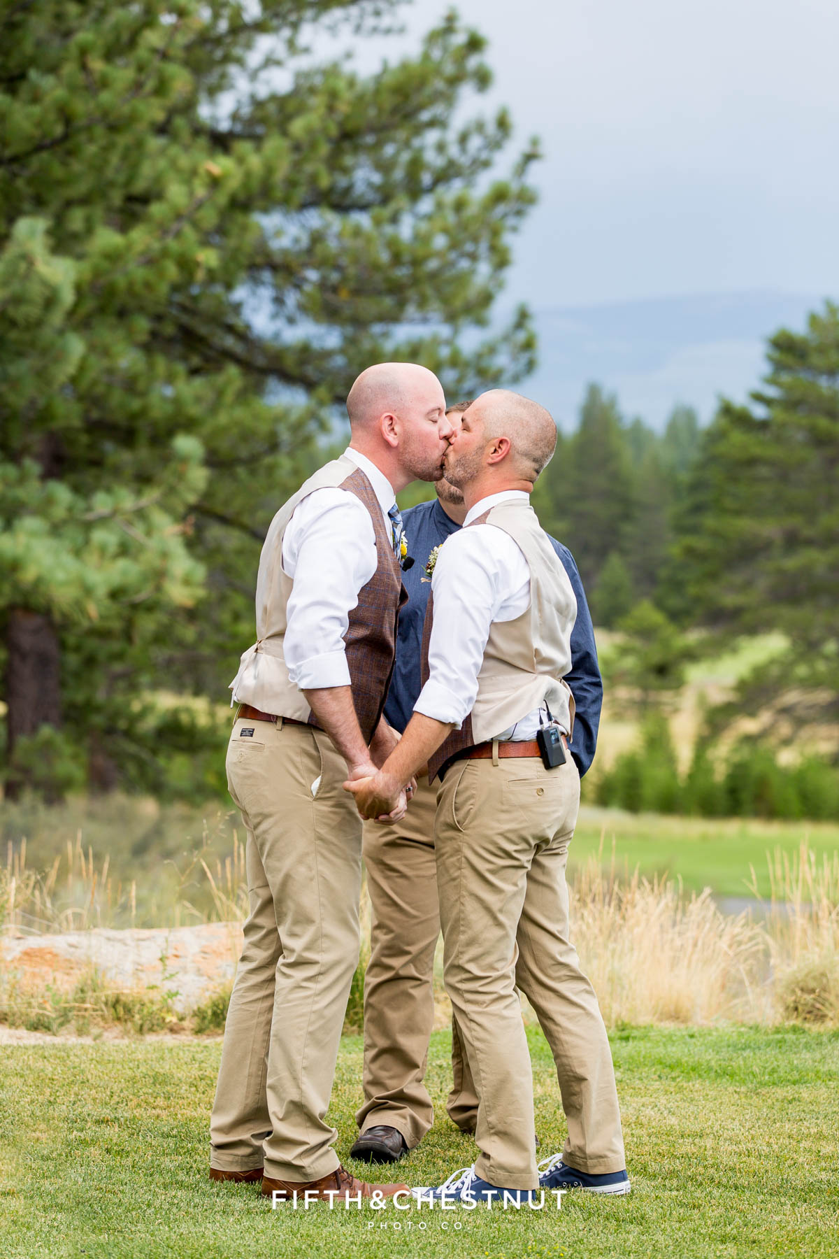 Grooms kiss as husband and husband during their PJ's at Gray's Crossing wedding