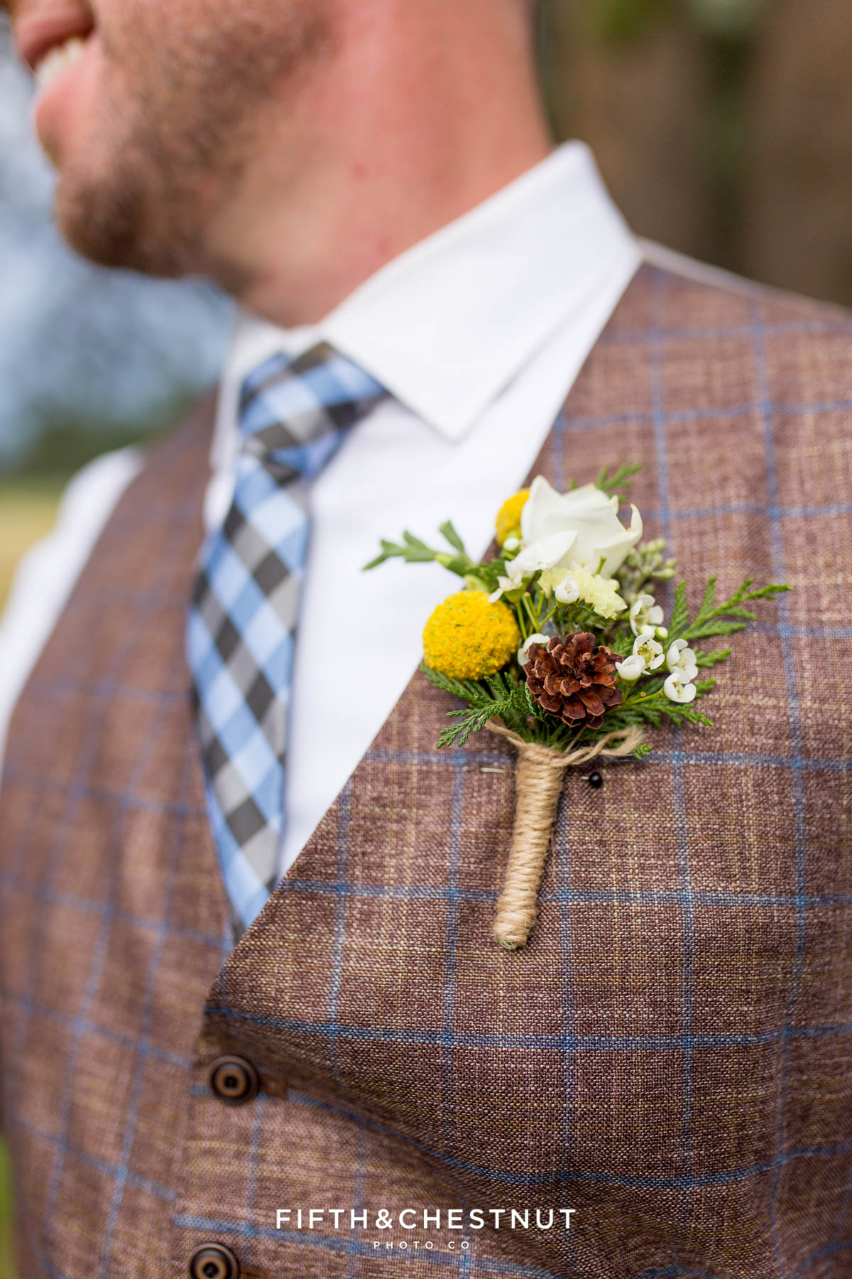 Close-up shot of groom's boutonniere by Suzu's Petals for his Truckee Wedding at PJ's at Gray's Crossing