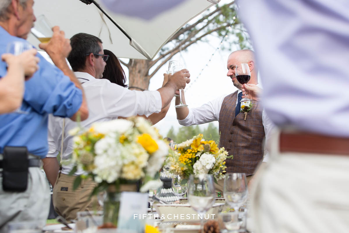 groom and guests raise glasses at a Truckee Wedding at PJ's at Gray's Crossing